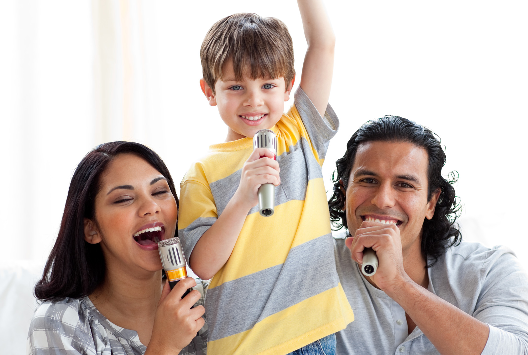 Boy Singing Karaoke With Parents