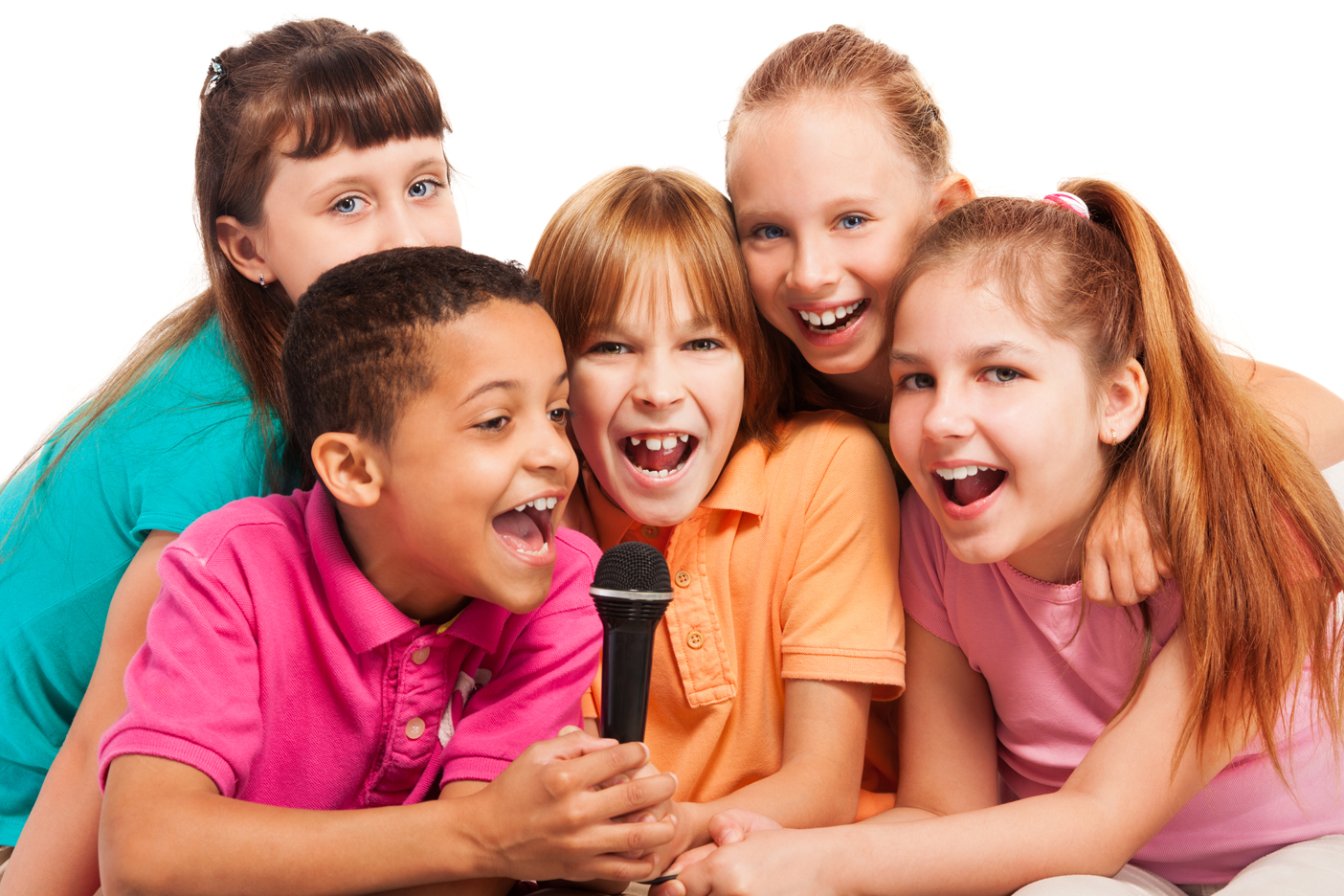 A Group of Children Singing Karaoke at a Party